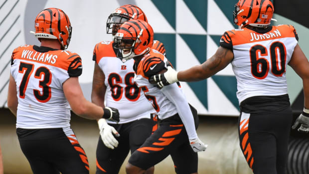 Sep 27, 2020; Philadelphia, Pennsylvania, USA; Cincinnati Bengals wide receiver Tee Higgins (85) celebrates his touchdown with offensive tackle Bobby Hart (68), offensive guard Mike Jordan (60), and offensive tackle Jonah Williams (73) against the Philadelphia Eagles during the third quarter at Lincoln Financial Field. Mandatory Credit: Eric Hartline-USA TODAY Sports