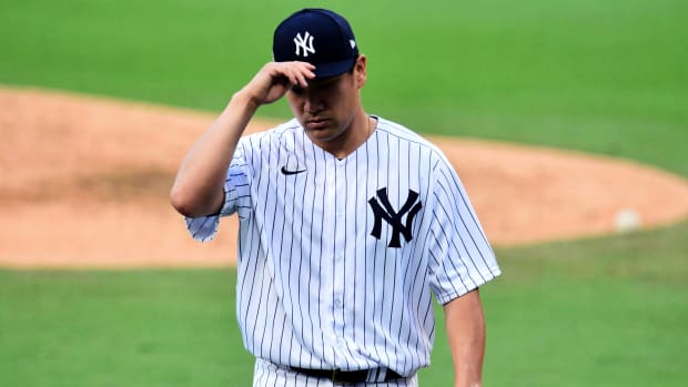 Oct 7, 2020; San Diego, California, USA; New York Yankees starting pitcher Masahiro Tanaka (19) reacts in the fourth inning against the Tampa Bay Rays during game three of the 2020 ALDS at Petco Park.