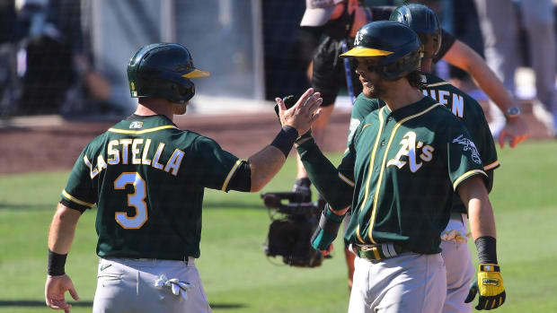 Chad Pinder greeted by Tommy La Stella after game-tying homer 10-07-2020