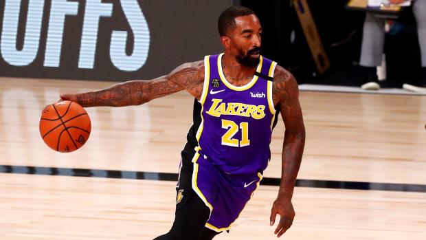 Aug 22, 2020; Lake Buena Vista, Florida, USA; Los Angeles Lakers guard JR Smith (21) controls the ball against the Portland Trail Blazers in the first half in game three of the first round of the 2020 NBA Playoffs at AdventHealth Arena.