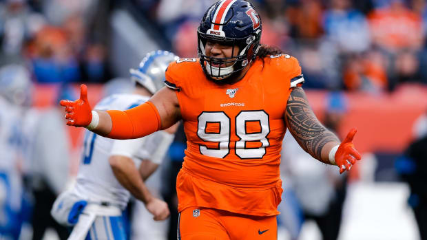 Denver Broncos nose tackle Mike Purcell (98) reacts after a play against the Detroit Lions in the third quarter at Empower Field at Mile High.