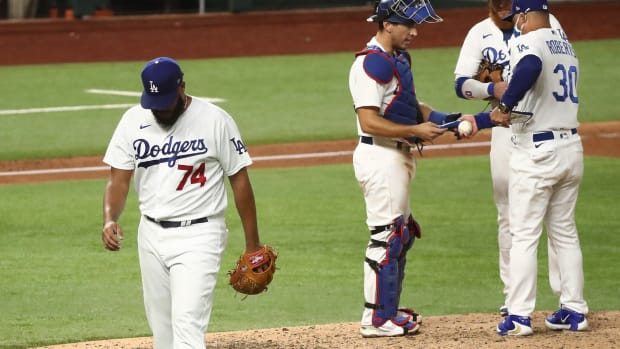 Oct 7, 2020; Arlington, Texas, USA; Los Angeles Dodgers relief pitcher Kenley Jansen (74) is removed from the game during the ninth inning in game two of the 2020 NLDS against the San Diego Padres at Globe Life Field. Mandatory Credit: Kevin Jairaj-USA TODAY Sports