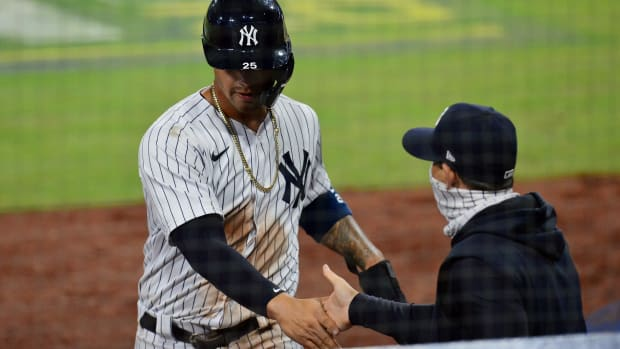 Gleyber Torres celebrates home run with Aaron Boone