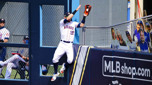 Josh Reddick steals a homer from Matt Olson