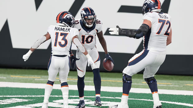 Denver Broncos wide receiver Jerry Jeudy (10) celebrates his touchdown with wide receiver K.J. Hamler (13) and offensive tackle Garett Bolles (72) during the first half against the New York Jets at MetLife Stadium.