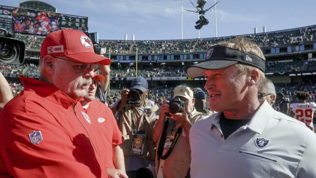 Sep 15, 2019; Oakland, CA, USA; Kansas City Chiefs head coach Andy Reid and Oakland Raiders head coach Jon Gruden meet after the game at the Oakland Coliseum. Mandatory Credit: Stan Szeto-USA TODAY Sports
