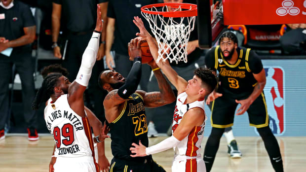 Los Angeles Lakers forward LeBron James (23) shoots the ball against Miami Heat forward Jae Crowder (99) and Miami Heat guard Tyler Herro (14) during the fourth quarter in game five of the 2020 NBA Finals