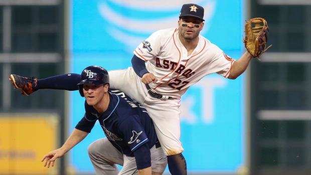 Tampa Bay Rays third baseman Joey Wendle (18) is forced out as Houston Astros second baseman Jose Altuve (27) throws onto first base in the ninth inning in game two of the 2019 ALDS