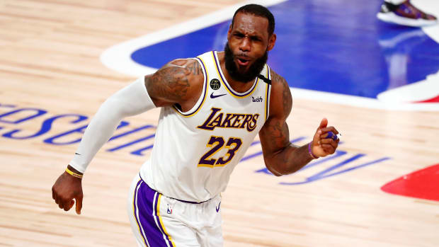 Los Angeles Lakers forward LeBron James (23) celebrates after a play against the Miami Heat during the fourth quarter in game six of the 2020 NBA Finals at AdventHealth Arena.