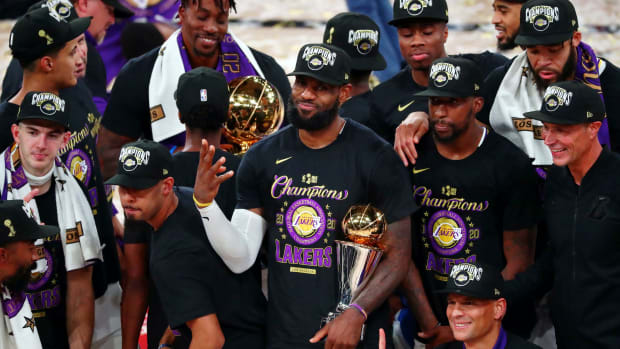 Los Angeles Lakers forward LeBron James (23) holds up four fingers after winning his fourth NBA championship after game six of the 2020 NBA Finals at AdventHealth Arena. The Los Angeles Lakers won 106...