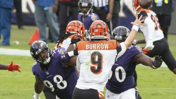Oct 11, 2020; Baltimore, Maryland, USA; Baltimore Ravens defensive tackle Brandon Williams (98) and outside linebacker Pernell McPhee (90) apply pressure as Cincinnati Bengals quarterback Joe Burrow (9) throws during the second quarter at M&T Bank Stadium. Mandatory Credit: Tommy Gilligan-USA TODAY Sports