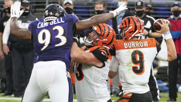 Oct 11, 2020; Baltimore, Maryland, USA; Baltimore Ravens defensive end Calais Campbell (93) applies pressure as Cincinnati Bengals offensive tackle Jonah Williams (73) attempts top block as quarterback Joe Burrow (9) throws during the second half at M&T Bank Stadium. Mandatory Credit: Tommy Gilligan-USA TODAY Sports
