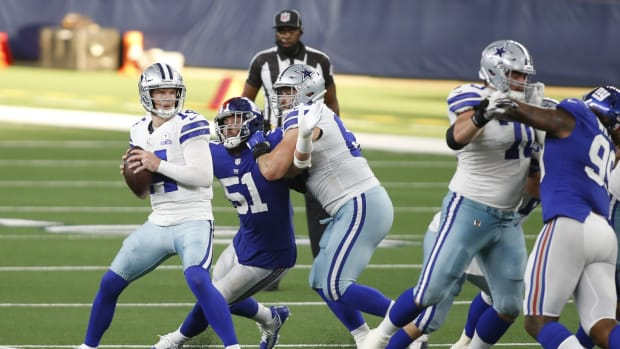 Oct 11, 2020; Arlington, Texas, USA; Dallas Cowboys quarterback Andy Dalton (14) looks to throw from the pocket in the fourth quarter against the New York Giants at AT&T Stadium.