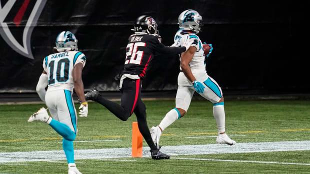 Oct 11, 2020; Atlanta, Georgia, USA; Carolina Panthers wide receiver DJ Moore (12) scores a touchdown behind Atlanta Falcons cornerback Isaiah Oliver (26) during the first half at Mercedes-Benz Stadium. Mandatory Credit: Dale Zanine-USA TODAY Sports