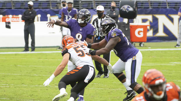 Oct 11, 2020; Baltimore, Maryland, USA; Baltimore Ravens quarterback Lamar Jackson (8) throws as Cincinnati Bengals linebacker Logan Wilson (55) applies pressure during the first quarter at M&T Bank Stadium. Mandatory Credit: Tommy Gilligan-USA TODAY Sports