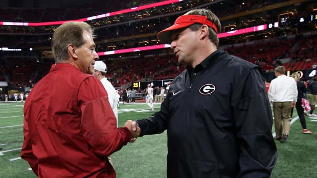 Nick Saban and Kirby Smart shake hands