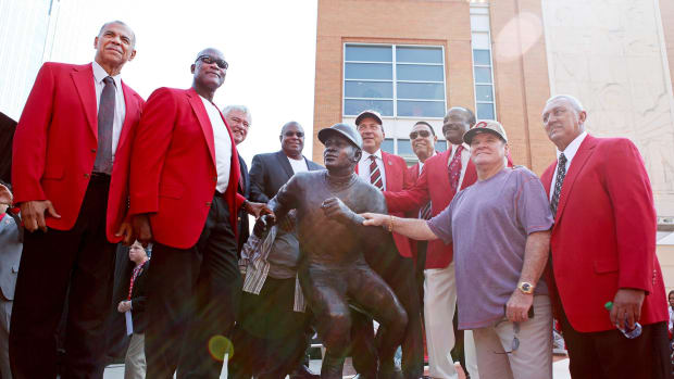 Members of the Reds Great Eight, Cesar Geronimo, left, George Foster, Reds CEO Bob Castellini, Ken Griffey, Sr., Johnny Bench, Tony Perez, Joe Morgan, Pete Rose and David Concepcion at the unveiling of the Joe Morgan statue in Cincinnati.