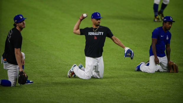 Oct 11, 2020; Arlington, TX, USA; Los Angeles Dodgers right fielder Mookie Betts (50) throws the ball as the Dodgers work out at Globe Life Park. Mandatory Credit: Jerome Miron-USA TODAY Sports