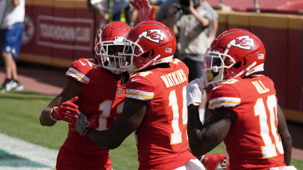 Oct 11, 2020; Kansas City, Missouri, USA; Kansas City Chiefs wide receiver Sammy Watkins (14) celebrates with wide receiver Tyreek Hill (10) and wide receiver Demarcus Robinson (11) after scoring on an 8-yard touchdown pass in the second quarter against the Las Vegas Raiders at Arrowhead Stadium. Mandatory Credit: Kirby Lee-USA TODAY Sports