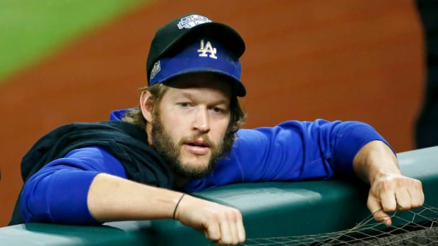 Oct 8, 2020; Arlington, Texas, USA; Los Angeles Dodgers starting pitcher Clayton Kershaw (22) wears an NLDS hat over his team hat after their win over the San Diego Padres after game three of the 2020 NLDS at Globe Life Field. The Los Angeles Dodgers won 12-3 to sweep the San Diego Padres. Mandatory Credit: Tim Heitman-USA TODAY Sports