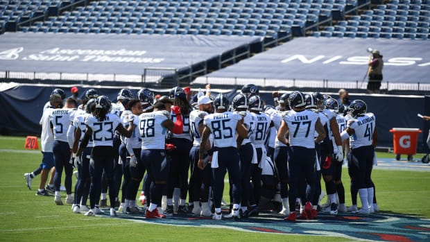 Tennessee Titans players huddle at mid field before the game against the Jacksonville Jaguars at Nissan Stadium.