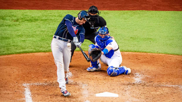 Oct 13, 2020; Arlington, Texas, USA; Atlanta Braves first baseman Freddie Freeman (5) hits a two run home run against the Los Angeles Dodgers during the fourth inning in  game two of the 2020 NLCS at Globe Life Field.