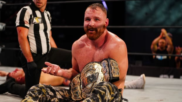 AEW's Jon Moxley with the world title belt after a match