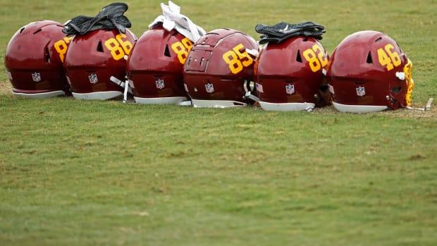 Aug 19, 2020; Ashburn, Virginia, USA; Helmets of Washington Football Team players rest on the field on day twenty-two of training camp at Inova Sports Performance Center in Ashburn, Virginia.