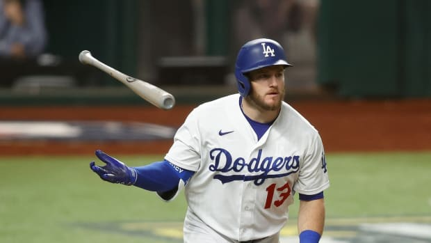 Oct 13, 2020; Arlington, Texas, USA; Los Angeles Dodgers first baseman Max Muncy (13) tosses his bat after hitting a two run home run during the ninth inning against the Atlanta Braves in game two of the 2020 NLCS at Globe Life Field. Mandatory Credit: Tim Heitman-USA TODAY Sports
