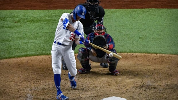 Oct 13, 2020; Arlington, Texas, USA; Los Angeles Dodgers center fielder Cody Bellinger (35) hits a triple against the Atlanta Braves during the ninth inning in game two of the 2020 NLCS at Globe Life Field. Mandatory Credit: Jerome Miron-USA TODAY Sports
