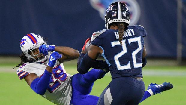 Tennessee Titans running back Derrick Henry (22) tosses Buffalo Bills cornerback Josh Norman (29) during the second quarter at Nissan Stadium Tuesday, Oct. 13, 2020 in Nashville, Tenn. An57980