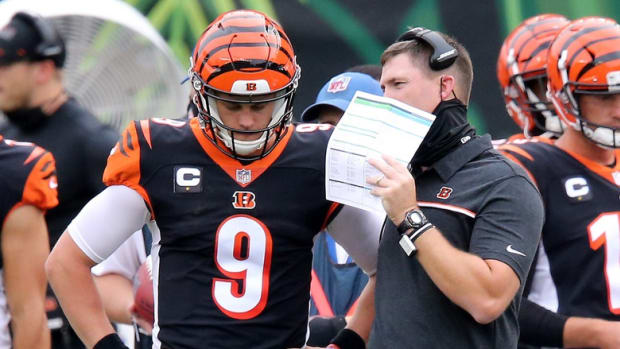 Cincinnati Bengals head coach Zac Taylor and Cincinnati Bengals quarterback Joe Burrow (9) talk during a timeout in the second quarter of a Week 1 NFL football game against the Los Angeles Chargers, Sunday, Sept. 13, 2020, at Paul Brown Stadium in Cincinnati. Los Angeles Chargers At Cincinnati Bengals Sept 13