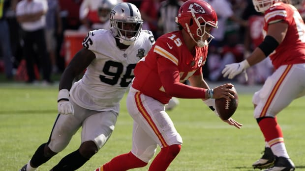Oct 11, 2020; Kansas City, Missouri, USA; Kansas City Chiefs quarterback Patrick Mahomes (15) is pressured by Las Vegas Raiders defensive end Clelin Ferrell (96) in the fourth quarter at Arrowhead Stadium. The Raiders defeated the Chiefs 40-32. Mandatory Credit: Kirby Lee-USA TODAY Sports
