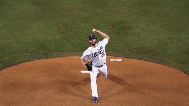 Oct 1, 2020; Los Angeles, California, USA; Los Angeles Dodgers starting pitcher Clayton Kershaw (22) delivers a pitch in the first inning against the Milwaukee Brewers during Game 2 of the National League Wild Card playoffs at Dodger Stadium. Mandatory Credit: Kirby Lee-USA TODAY Sports