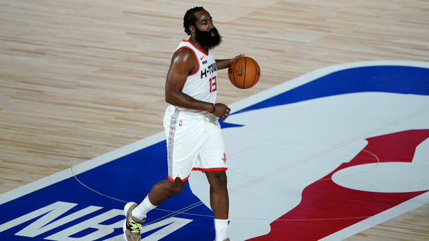 Houston Rockets player James Harden dribbles down the court