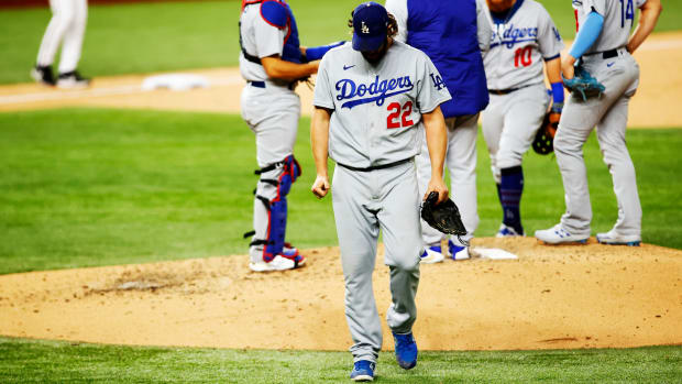 Oct 15, 2020; Arlington, Texas, USA; Los Angeles Dodgers starting pitcher Clayton Kershaw (22) walks to the dugout after being removed from the game during the sixth inning of game four of the 2020 NLCS against the Atlanta Braves at Globe Life Field. Mandatory Credit: Tim Heitman-USA TODAY Sports
