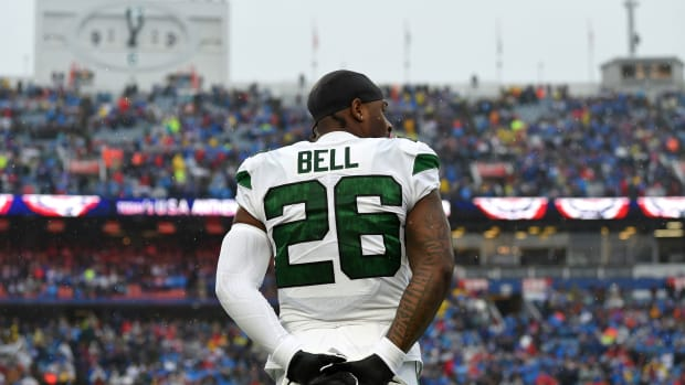 Dec 29, 2019; Orchard Park, New York, USA; New York Jets running back Le'Veon Bell (26) looks on during the National Anthem prior to the game against the Buffalo Bills at New Era Field. Mandatory Credit: Rich Barnes-USA TODAY Sports