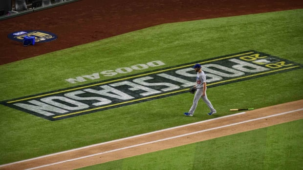 Oct 15, 2020; Arlington, Texas, USA; Los Angeles Dodgers starting pitcher Clayton Kershaw (22) walks off the field during the first inning against the Atlanta Braves in game four of the 2020 NLCS at Globe Life Field. Mandatory Credit: Jerome Miron-USA TODAY Sports