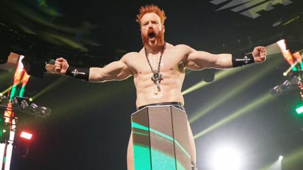 WWE's Sheamus poses atop the ring post