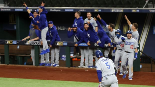 Oct 16, 2020; Arlington, Texas, USA; Los Angeles Dodgers shortstop Corey Seager (5) celebrates his two run homerun against the Atlanta Braves during the seventh inning in game five of the 2020 NLCS at Globe Life Field. Mandatory Credit: Kevin Jairaj-USA TODAY Sports