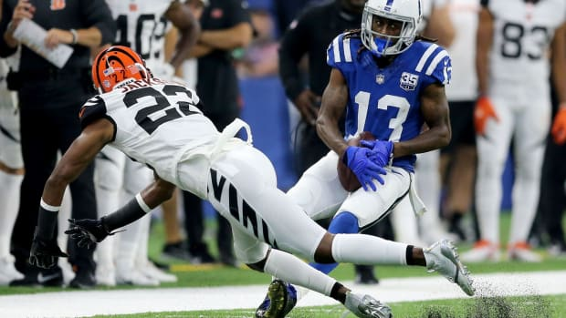 Indianapolis Colts wide receiver T.Y. Hilton (13) pins a ball for a reception as Cincinnati Bengals cornerback William Jackson (22) defends in the second quarter during the Week 1 NFL game between the Cincinnati Bengals and the Indianapolis Colts, Sunday, Sept. 9, 2018, at Lucas Oil Stadium in Indianapolis. Cincinnati Bengals Vs Indianapolis Colts Sept 9