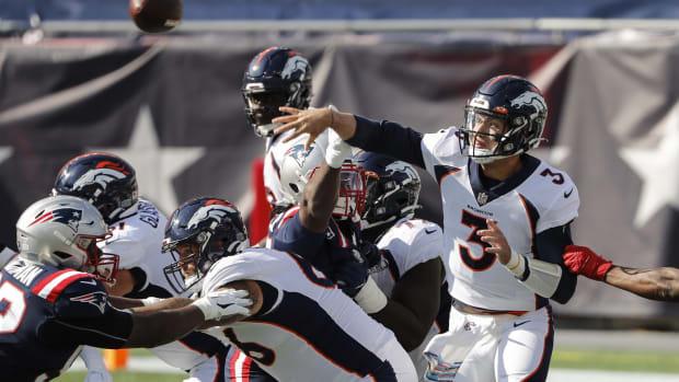 Denver Broncos quarterback Drew Lock (3) throws under pressure against the New England Patriots during the first quarter at Gillette Stadium.