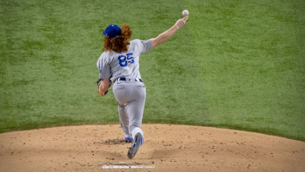 Oct 16, 2020; Arlington, Texas, USA; Los Angeles Dodgers starting pitcher Dustin May (85) pitches to the Atlanta Braves during the first inning in game five of the 2020 NLCS at Globe Life Field. Mandatory Credit: Jerome Miron-USA TODAY Sports