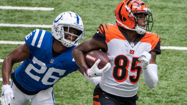 Oct 18, 2020; Indianapolis, Indiana, USA; Cincinnati Bengals wide receiver Tee Higgins (85) runs with the ball while Indianapolis Colts cornerback Rock Ya-Sin (26) defends in the first half at Lucas Oil Stadium. Mandatory Credit: Trevor Ruszkowski-USA TODAY Sports