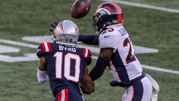 Denver Broncos cornerback Michael Ojemudia (23) breaks up a pass intended for New England Patriots receiver Damiere Byrd (10) during the second half at Gillette Stadium.