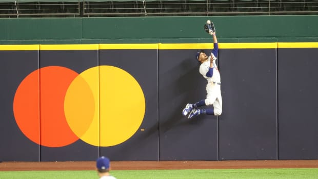 Oct 18, 2020; Arlington, Texas, USA; Los Angeles Dodgers right fielder Mookie Betts (50) makes a catch against Atlanta Braves right fielder Ronald Acuna Jr. (not pictured) in the fifth inning during game seven of the 2020 NLCS at Globe Life Field. Mandatory Credit: Kevin Jairaj-USA TODAY Sports