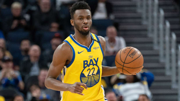Golden State Warriors guard Andrew Wiggins dribbles the basketball