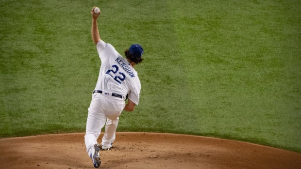 Oct 20, 2020; Arlington, Texas, USA; Los Angeles Dodgers starting pitcher Clayton Kershaw (22) pitches against the Tampa Bay Rays during the first inning in game one of the 2020 World Series at Globe Life Field. Mandatory Credit: Jerome Miron-USA TODAY Sports