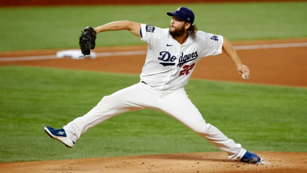 Oct 20, 2020; Arlington, Texas, USA; Los Angeles Dodgers starting pitcher Clayton Kershaw (22) delivers a pitch in the 1st inning against the Tampa Bay Rays during game one of the 2020 World Series at Globe Life Field.