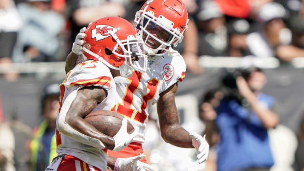 Sep 15, 2019; Oakland, CA, USA; Kansas City Chiefs wide receiver Demarcus Robinson (11) congratulates wide receiver Mecole Hardman (17) during the game against the Oakland Raiders during the second quarter at the Oakland Coliseum. Mandatory Credit: Stan Szeto-USA TODAY Sports